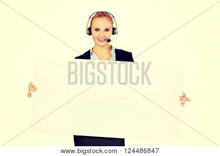 Smile call center woman holding empty banner