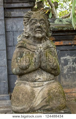 Traditional guard statue carved in stone on Bali island.