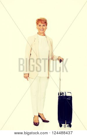 Smile senior woman with suitcase