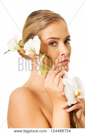 Beautiful nude woman holding white orchid flower