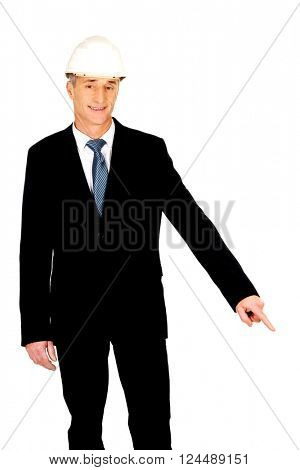 Smiling businessman with hard hat pointing down