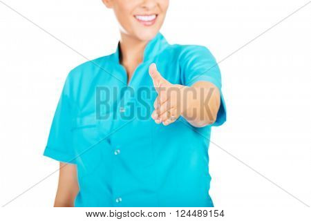 Smile female doctor or nurse giving hand for handshaking