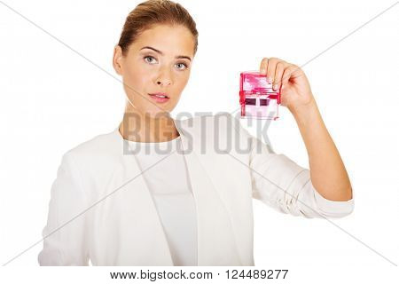 Young businesswoman holding pink rubber stamp