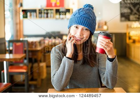 Young woman having her coffee at morning