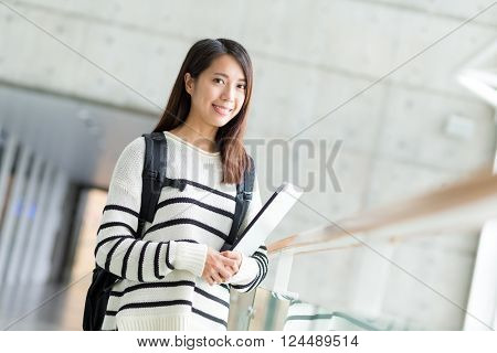 Woman with backpack and laptop computer