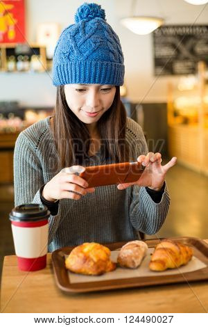 Woman take photo on her breakfast