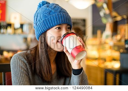 Woman drinking of coffee in cafe