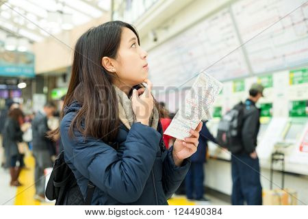 Woman search map for direction for her trip