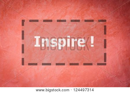 Inspire word inspirational quote on handmade creative red wall background