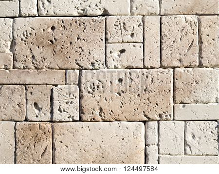 Decorative relief cladding slabs imitating stones on wall closeup