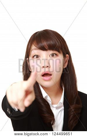 portrait of  young Japanese businesswoman witnessed something