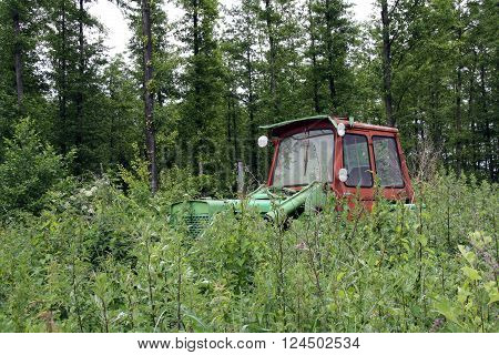 An old tractor discarded in the forest