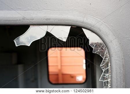 destroyed window of a railway carriage in the Port of Magdeburg