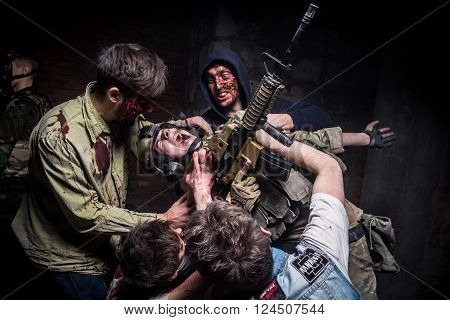 KIEV,UKRAINE - February 20 : Group zombie attack soldier with gun during a thematic game about zombies in Kiev,Ukraine on February 20,2016.