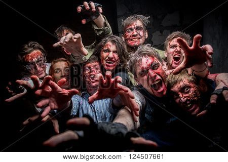 KIEV,UKRAINE - February 20 : Group of crazy zombies with bloody and disfigured faces during the quest game in zombie theme in Kiev,Ukraine on February 20,2016.