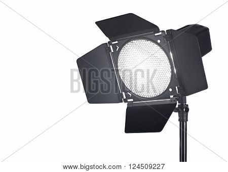 Studio flash with barndoors and grid on white background