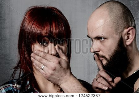 Strong Bearded Man Covering Woman Face
