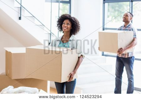 Smiling young couple moving together in a new house