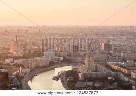 Sunrise in foggy day. Hotel Ukraine, Moskva river, building of Russian Government in Moscow