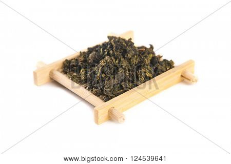Tie Guan Yin Oolong tea on bamboo serving tray, isolated on white background