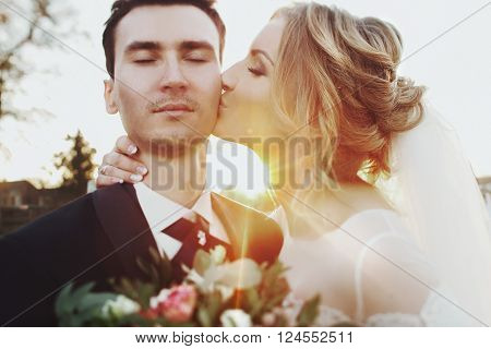 Beautiful Newlywed Bride & Groom Kissing At Sunset Face Closeup
