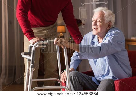Image of disabled senior man with walking zimmer