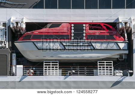 White and red life boat of a big modern cruise liner in the ocean ** Note: Visible grain at 100%, best at smaller sizes