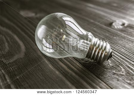 Incandescent Lamp On The Wooden Rustic Background