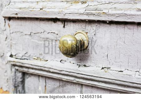 Door handle on an antique wooden door