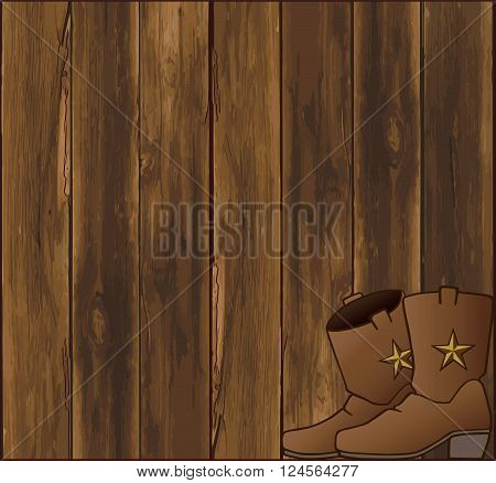 Cowboy boots resting in front of a weathered barn wall