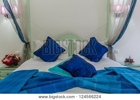Canopy bed in moroccan luxury hotel .