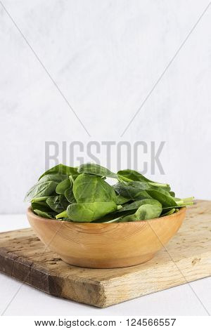 Spinach Leaves In Bowl On A White Background