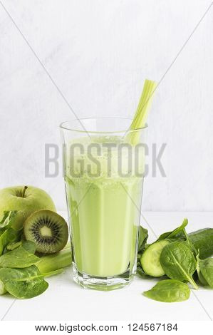 Ingredients For Smoothie: Spinach, Kiwi, Apple, Celery On A White Background