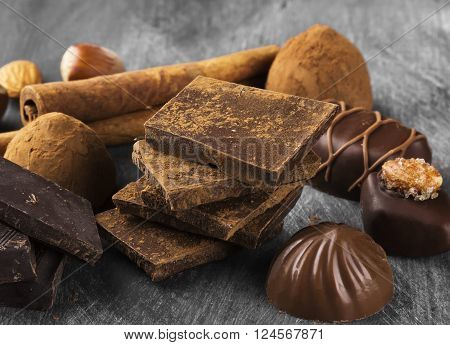 Various Confectionery: Chocolate, Candies On A Dark Background