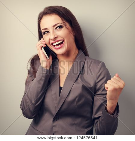 Happy Business Successful Excited Woman Talking On Mobile Phone And Showing Victory Sign By Fist