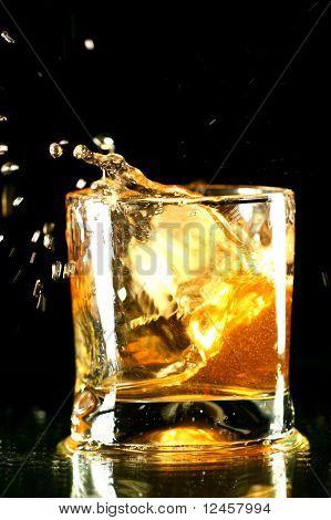 whiskey splash on black background