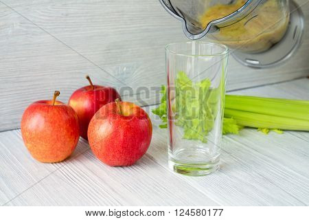 Smoothies Made From Apples And Celery Poured Into Empty Glass