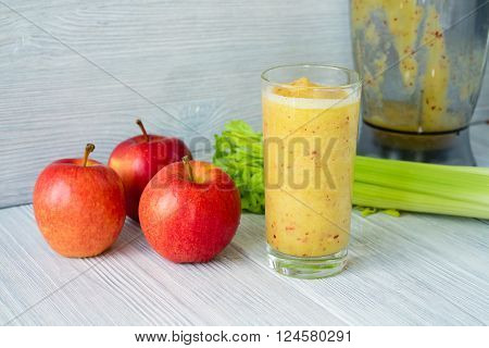 Smoothies Made From Apples And Celery In A Glass On A Table Near The Food Processor