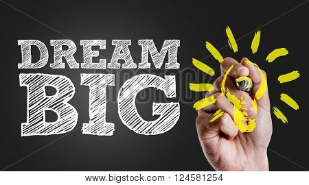 Hand writing the text: Dream Big