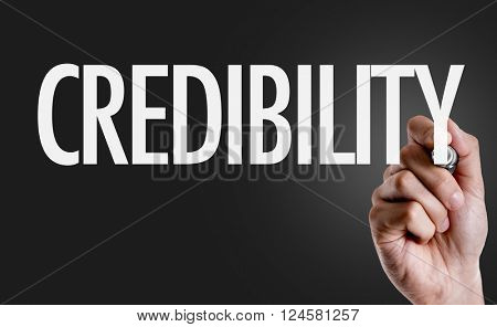 Hand writing the text: Credibility poster