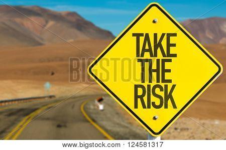 Take The Risk sign on desert road