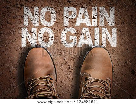Top View of Boot on the trail with the text: No Pain No Gain