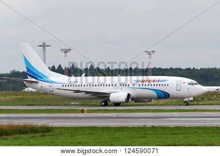 DOMODEDOVO RUSSIA - JULY 20: Aircraft operated by JSC Yamal Airlines ready to take off at Moscow airport in Domodedovo on July 20 2013. The company in its fleet has 9 aircraft Boeing-737
