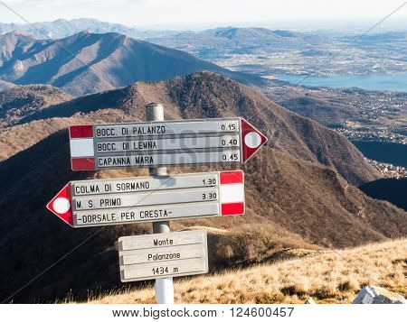 Signs indicating paths in the hills near Lecco and Como in northern Lombardia in Italy