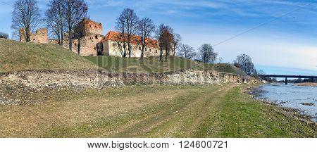 Old medieval castle near river in Bauska town, Latvia