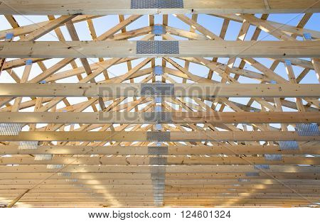 wooden framework in process of roof constraction