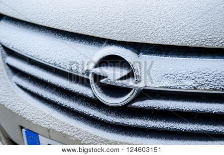 PARIS FRANCE - JAN 20 2016: Opel AG logotype covered with snow flakes during cold period on Paris streets
