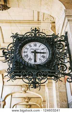 PARIS FRANCE - AUGUST 18 2014: Henry Lepaute street clock ornated with steel flowers and decorations on the streets of Paris France