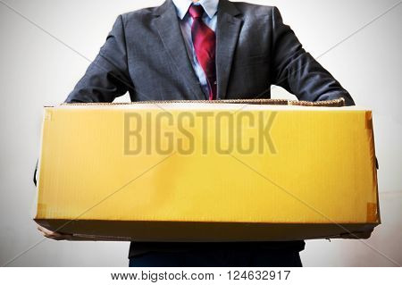 Business man carrying an old box with hard work - empty box ready to fill in text - business workdebt too much work and burden concept