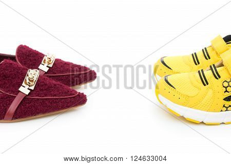 yellow shoes for son and red ones for mom on white as filiation concept